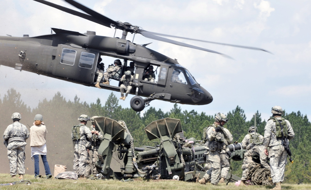 Army National Guard members take part in an exercise July 19 at the Camp Grayling Joint Maneuver Training Center in Grayling, Mich.