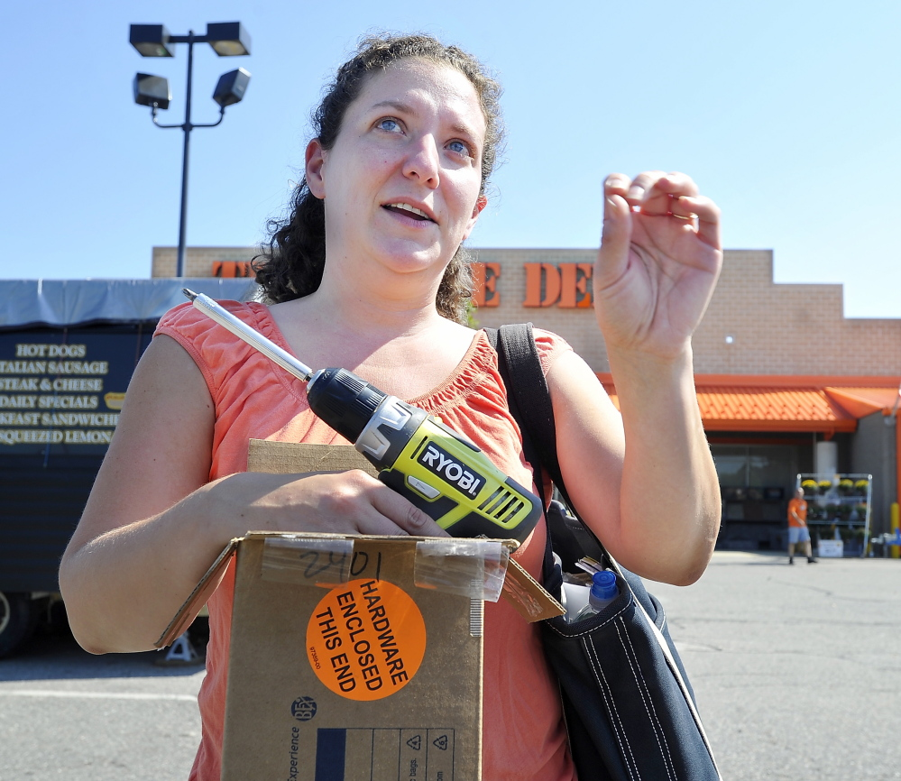 "Celena Cerovski of Rockland used her credit card to buy things at Home Depot. ""I'm not too worried,"" about the recent Home Deport credit card data hack, she said."