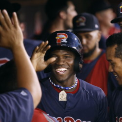 Rusney Castillo of the Portland Sea Dogs celebrates with teammates after scoring in the fifth inning of Friday night's playoff against Binghamton.