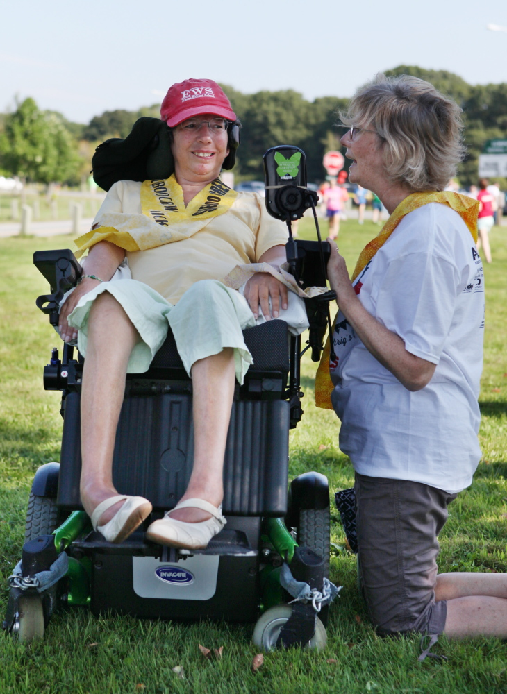 Lesley Sneddon, of Newton, Mass., speaks with friend Sue Gawler on Saturday before the start of the Walk to Defeat ALS in Portland. Gawler has had ALS for four years and has raised over $10,000 for research efforts.