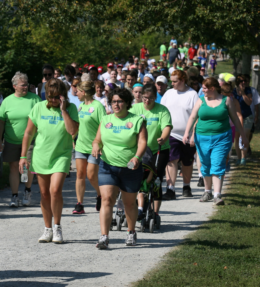 Participants walk around Back Cove on Saturday during the Walk to Defeat ALS.
