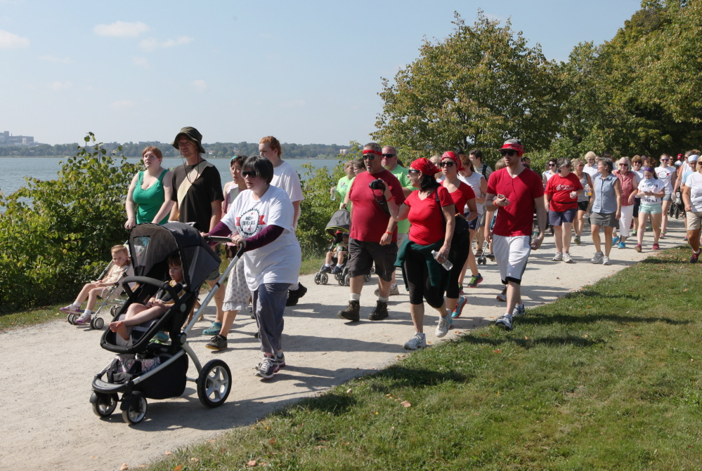 Participants walk around Back Cove on Saturday during the Walk to Defeat ALS in Portland. Joel Page/Staff Photographer