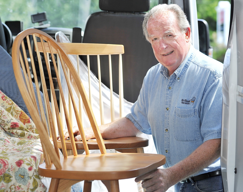 Dan Maxham, Owner Of W.A. Mitchell Fine Furniture In Farmington, Is Shown  Delivering His