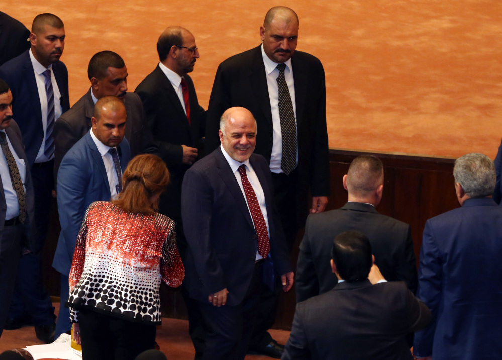 Iraq's new Prime Minister Haider al-Abadi, center, attends the Parliament session to submit his government in Baghdad, Iraq, on Monday.