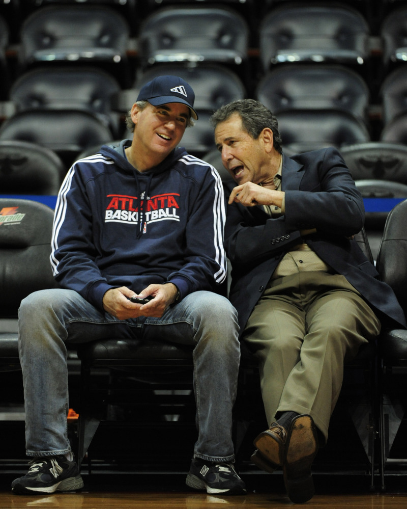 In this Dec. 22, 2011, file photo, Atlanta Hawks co-owners Michael Gearon Jr., left, and Bruce Levenson talk prior to the first half of an NBA preseason basketball game at Philips Arena in Atlanta. Hawks general manager Danny Ferry has been disciplined by CEO Steve Koonin for making racially charged comments about Luol Deng when the team pursued the free agent this year.