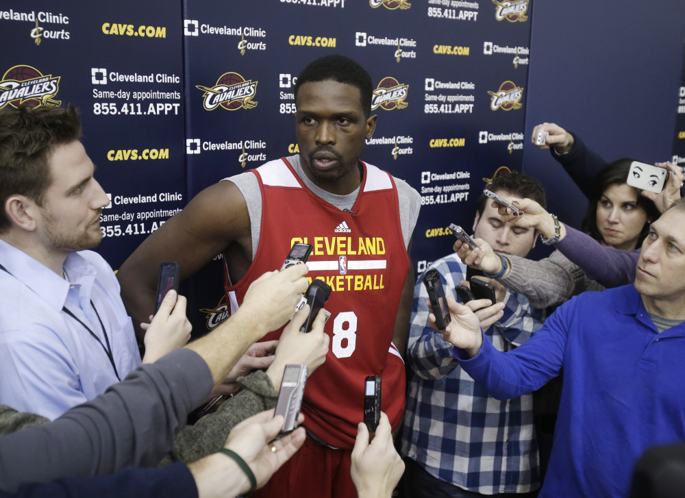In this Jan. 8, 2014, file photo, then-Cleveland Cavaliers forward Luol Deng talks with reporters after practice in Independence, Ohio.