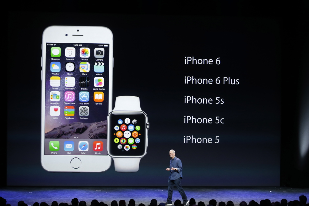 Apple CEO Tim Cook speaks during an Apple event announcing the iPhone 6 and the Apple Watch in Cupertino, Calif., on Monday.