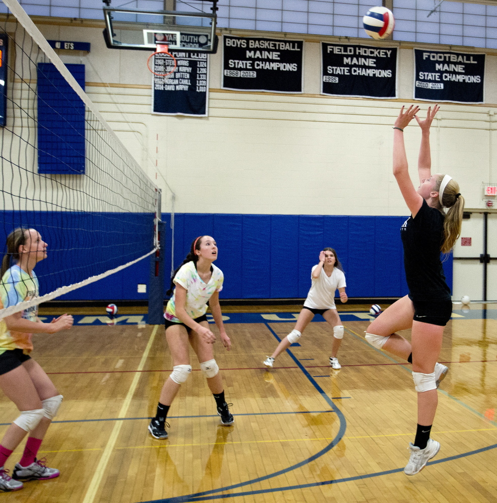Yarmouth is one of just two Class B teams in southern Maine and must travel Down East to face the competition they will see in the playoffs. But the Clippers make the long trips work for them. During a recent Yarmouth practice Alison Clark goes up for a return.