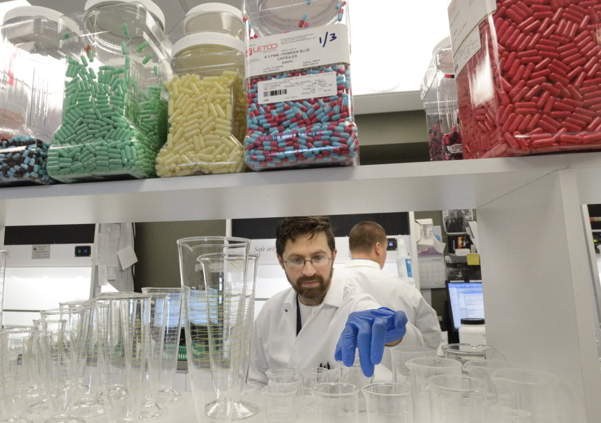 Compounding technician Travis Agaman works at Apothecary by Design's facility at 141 Preble St. Its original retail pharmacy is located at 84 Marginal Way.