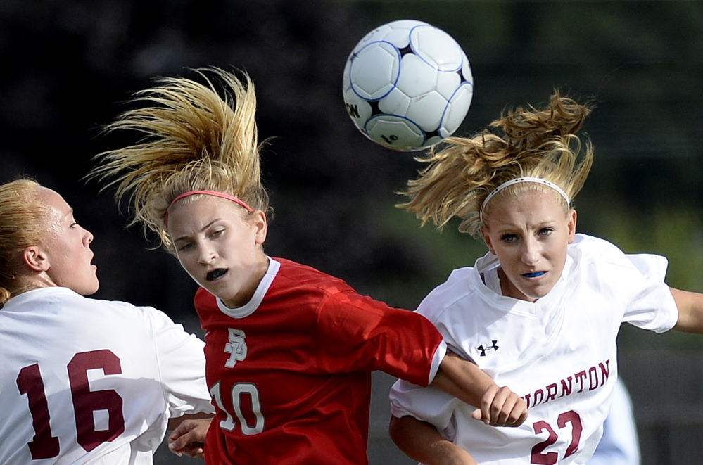South Portland's Callie O'Brien, middle, goes up for the ball between two Thornton Academy players, Katherine Gillespie, left, and Hannah McAlary in Wednesday's girls' soccer game at Saco. The Trojans won, 6-1.