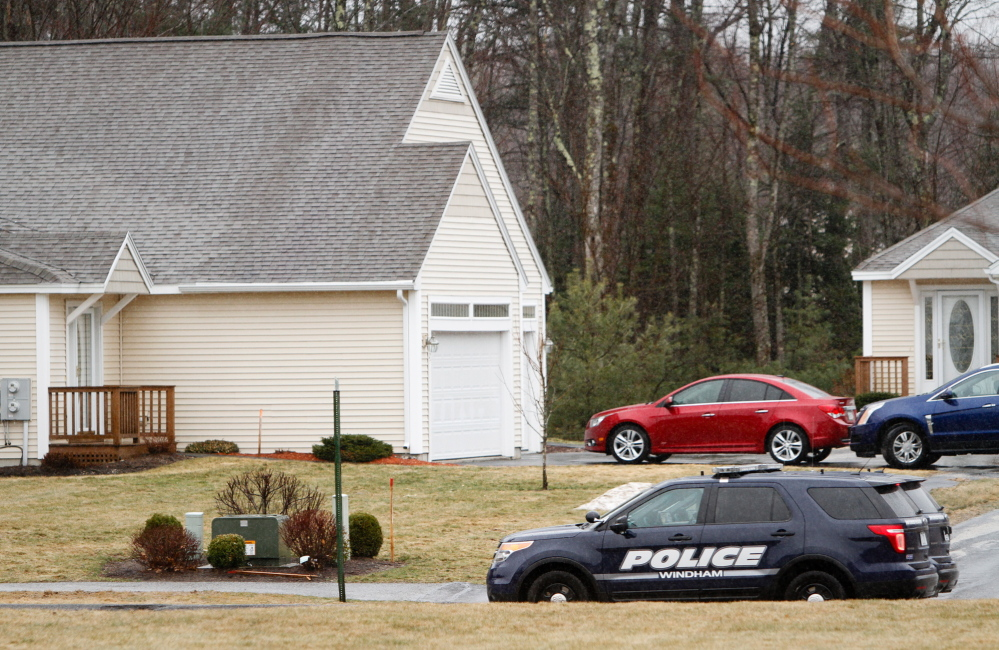 Police vehicles are parked in April outside 2 Searsport Way in Windham, where Cumberland County Sheriff's Deputy Nicholas Mangino shot and killed 66 year-old Stephen McKenney in his driveway when McKenney refused to drop a handgun and walked toward Mangino.