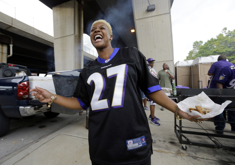 Karla Owens wears a Baltimore Ravens Ray Rice jersey as she tailgates before the Ravens' game against the Pittsburgh Steelers on Thursday night in Baltimore.