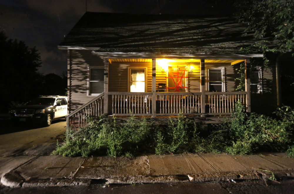 A Blackstone, Mass. police vehicle sits next to a house where a Massachusetts prosecutor said the bodies of three infants were found in Blackstone. Worcester County District Attorney Joseph Early Jr. said authorities don't know when or how the babies died.