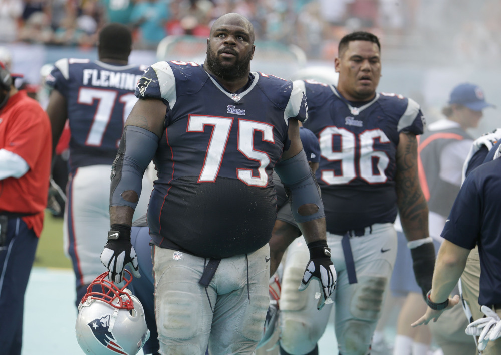 Defensive tackle Vince Wilfork glances at an unexpected score Sunday in the opener for the New England Patriots at Miami. A loss in the opener is rare enough – last done in 2003 – but going 0-2 is something the team hasn't done in 13 years. New England is at Minnesota on Sunday.