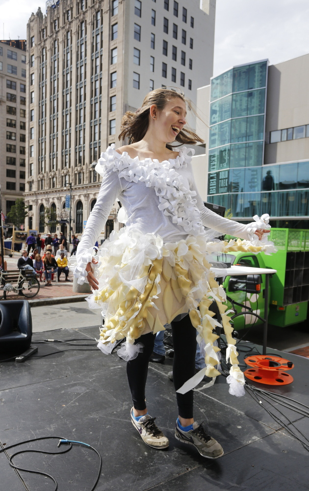 Kate Burgess, a freshman at the University of New England, takes the stage wearing an outfit made of recycled materials during an eco-fashion show Saturday as part of the first Portland Greenfest. Burgess, of Chelmsford, Mass., is majoring in environmental science.