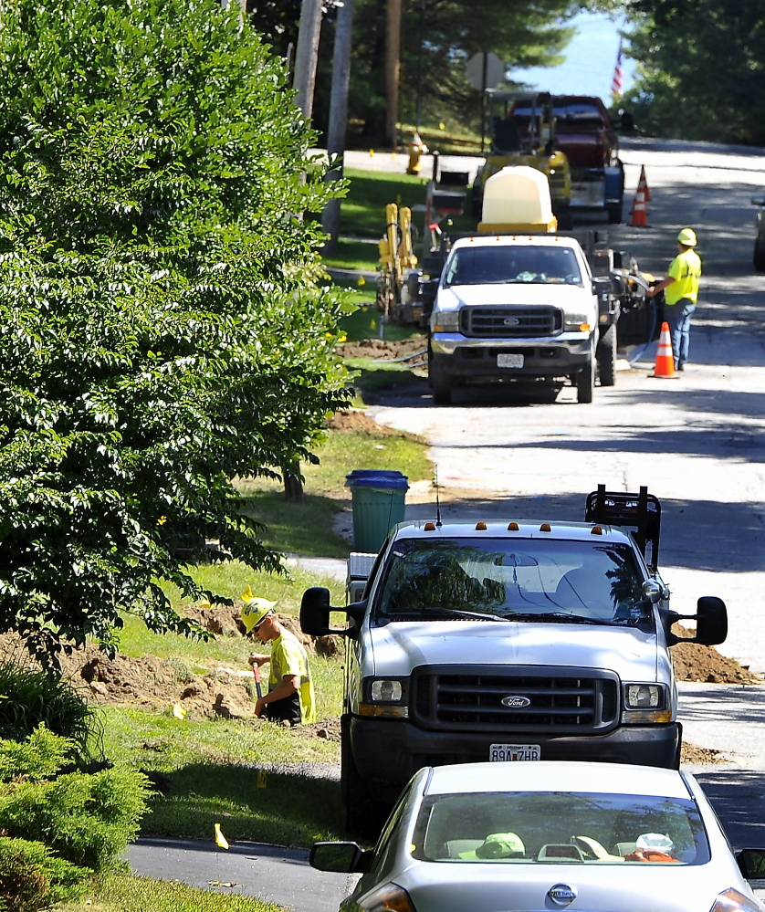 CUMBERLAND, ME - SEPTEMBER 10: A crew from Midwest Utility out of Missouri installs the distribution lines that connect the homes to the supply lines buried along Wildwood Boulevard that connect to the main 8' pipe along Route 88 in Cumberland Foreside.