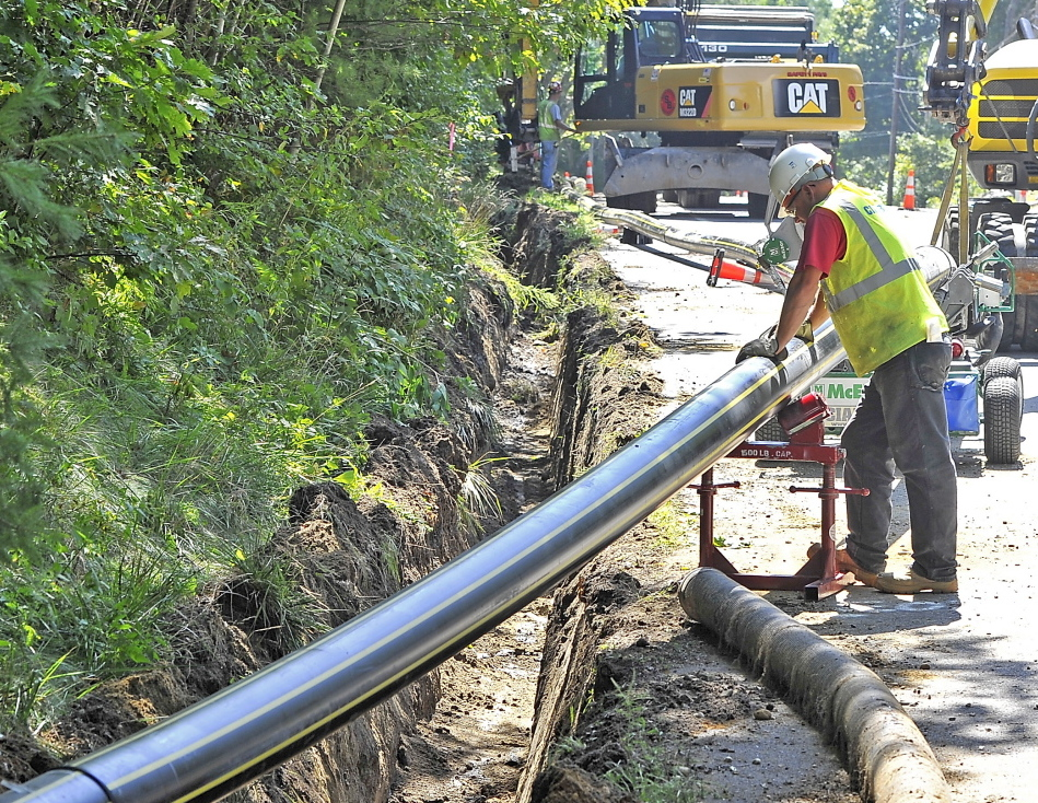 A Cianbro crew prepares to bury natural-gas pipe along Route 88 in Cumberland in early September. Summit Natural Gas of Maine is also laying pipe in Falmouth and Yarmouth.