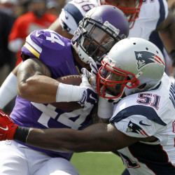 Minnesota Vikings running back Matt Asiata, left, is stopped for a 2-yard loss by New England Patriots linebacker Jerod Mayo in the first quarter of Sunday's game at Minneapolis.