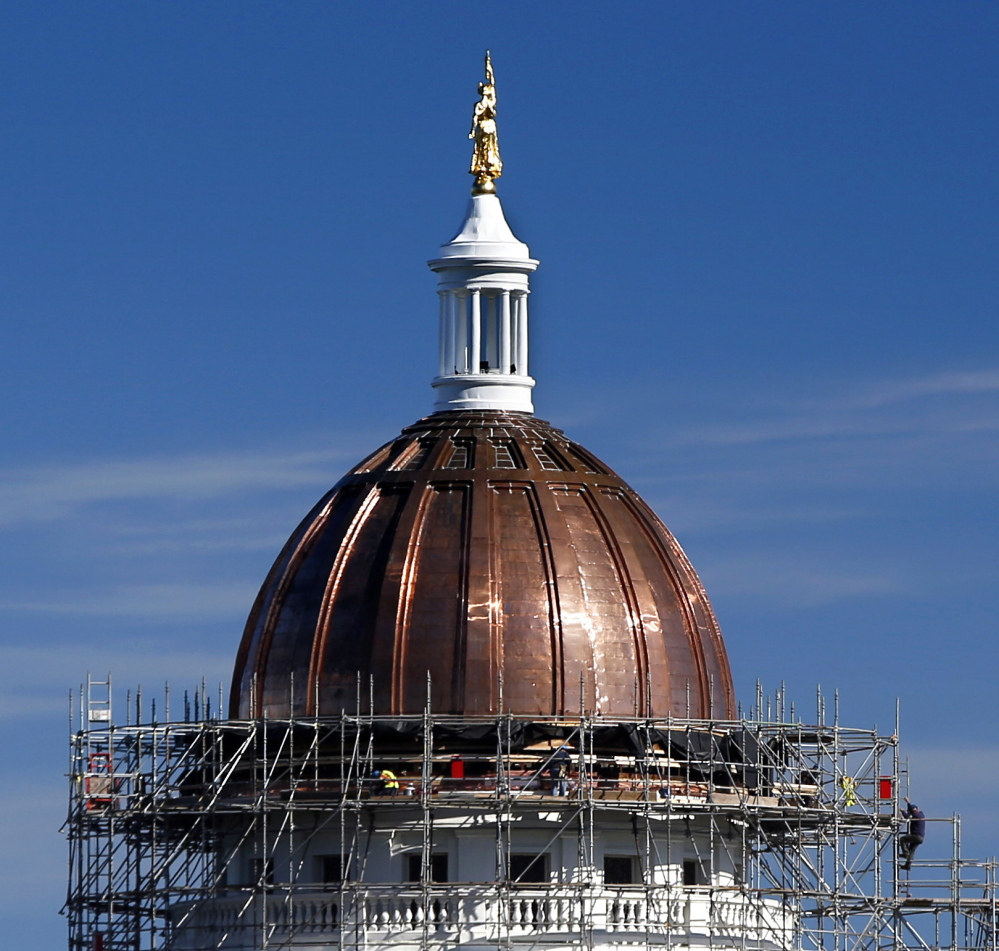 Work continues Friday on the State House dome in Augusta. Legislative leaders are deciding what to do with the 7,000 square feet of old, tarnished copper that's been removed.
