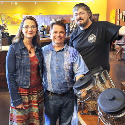 From left, Coffee By Design owners Mary Allen Lindemann and Alan Spear and head roaster Dylan Hardman are shown in their new place of business at 1 Diamond St. in Portland.