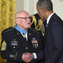 President Obama shakes hands with retired Army Command Sgt. Maj. Bennie G. Adkins after presenting him with the Medal of Honor at the White House on Monday.