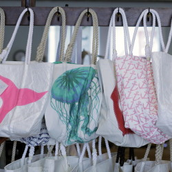 PORTLAND, ME Ð SEPTEMBER 9: Tote bags made from recycled sails hang in the showroom at Sea Bags in Portland, Tues. September 9, 2014.ÊThe Sea Bags company manufactures tote bags, duffels, coasters, tech covers and more out of recycled sails at its shop on the Portland waterfront.  (Photo by Amelia Kunhardt/Staff Photographer)