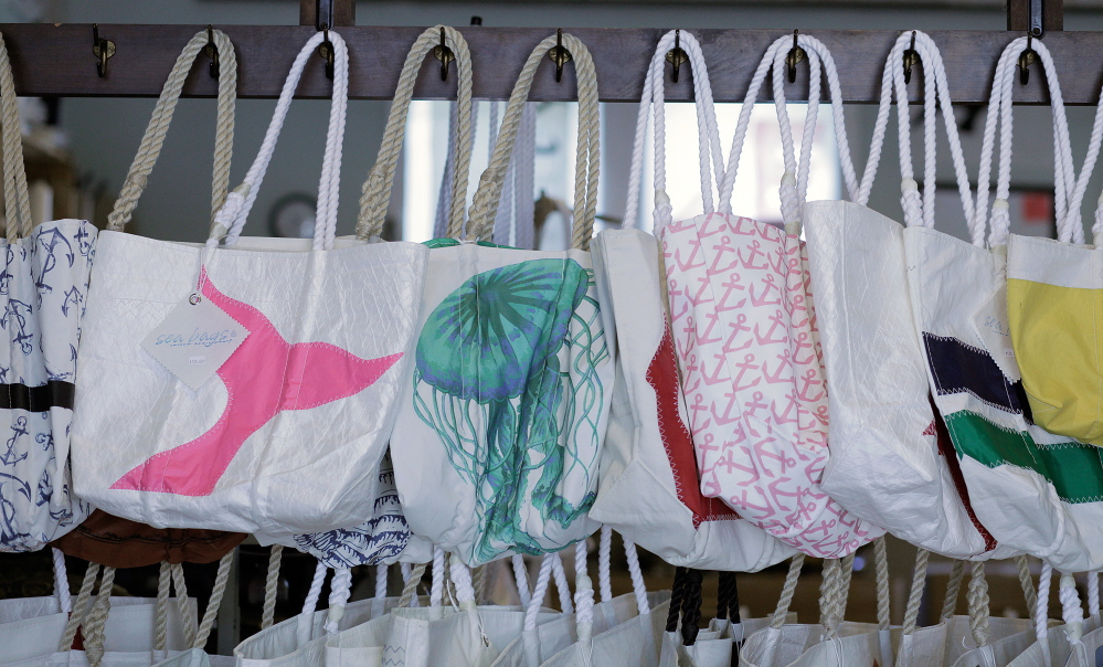 Tote bags made from recycled sails hang in the showroom at Sea Bags in Portland.