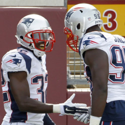 Devin McCourty, left, is congratulated by Chandler Jones after intercepting a pass and running it back 60 yards in the Patriots' 30-7 win at Minnesota Sunday. The Associated Press