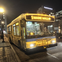 Portland Metro bus at a bus stop on Elm Street. John Ewing/Staff Photographer