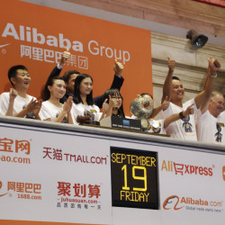 Alibaba employees attend the opening bell ceremony during the Hangzhou, China-based company's initial public offering Friday at the New York Stock Exchange. Shares in the e-commerce company closed at $93.89. The Associated Press