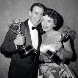 """Writer Carl Reiner and actress Polly Bergen pose with their statuettes at the Emmy Awards presentations in New York in 1958. Reiner won for best continuing supporting performance by an actor in a dramatic or comedy series for """"Caesar's Hour.""""  Bergen won best single performance by an actress in a lead or support role for """"Playhouse 90:  Helen Morgan Story."""" Bergen, an  Emmy-winning actress and singer, who in a long career played the terrorized wife in the original """"Cape Fear"""" and the first woman president in """"Kisses for My President,"""" died Saturday."""
