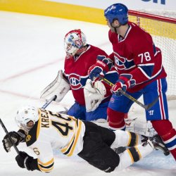 Boston Bruins center David Krejci is knocked to the ice by Montreal defenseman Joe Finley in front of goalie Dustin Tokarski during Tuesday's exhibition in Montreal.