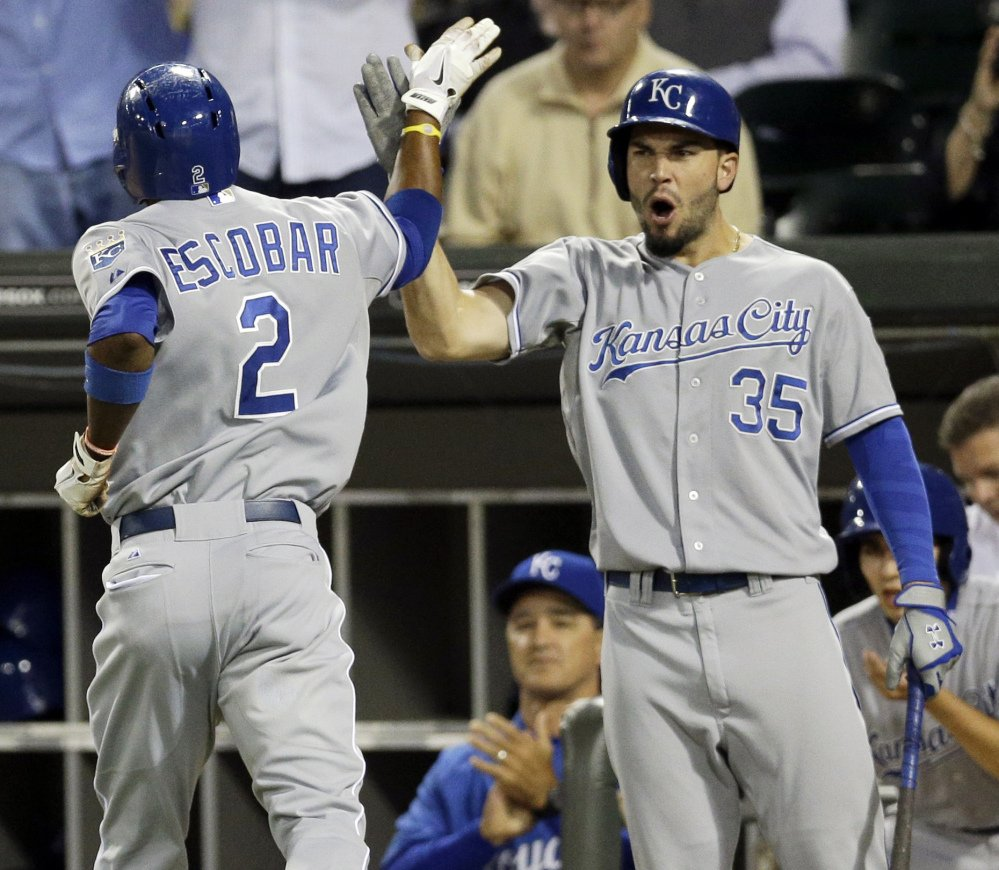 Alcides Escobar, left, of the Royals celebrates with Eric Hosmer after scoring during Friday's win in Chicago that ended the team's long playoff drought.