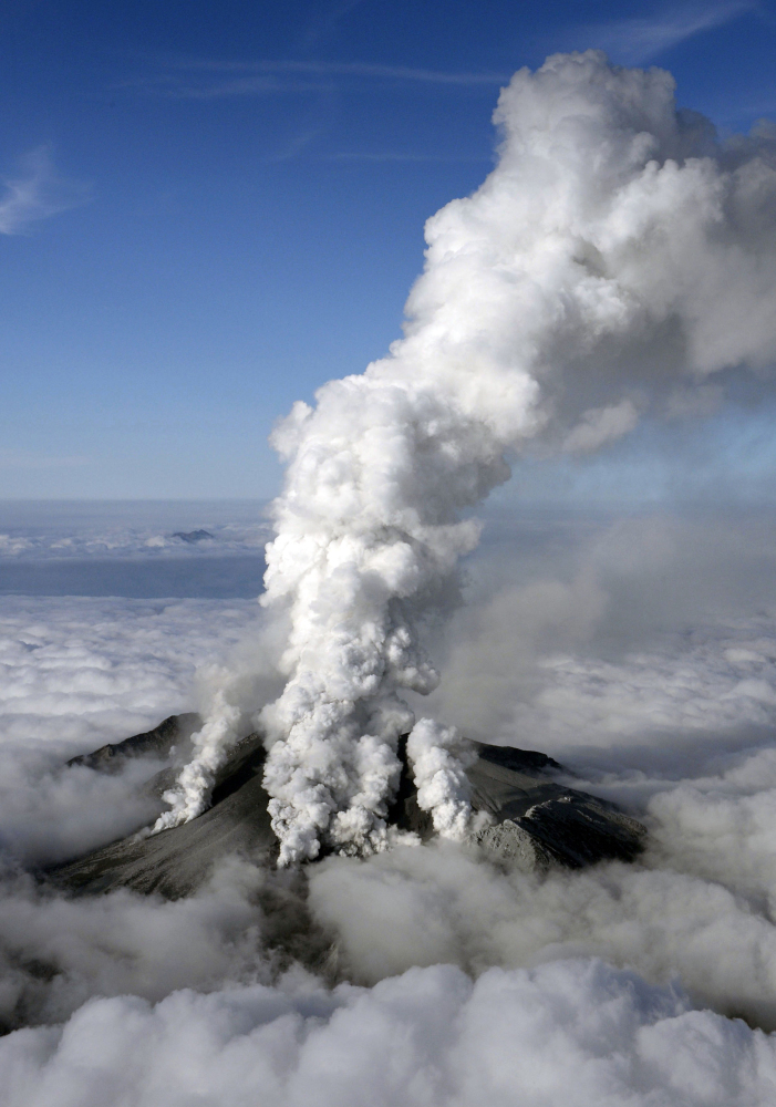 Dense white plumes are spewed out from Mt. Ontake as the volcanic mountain erupts in central Japan on Saturday. With a sound likened to thunder, the 10,062-foot mountain spewed large white plumes high into the sky, sending people fleeing, covering surrounding areas in ash and trapping more than 250 climbers.