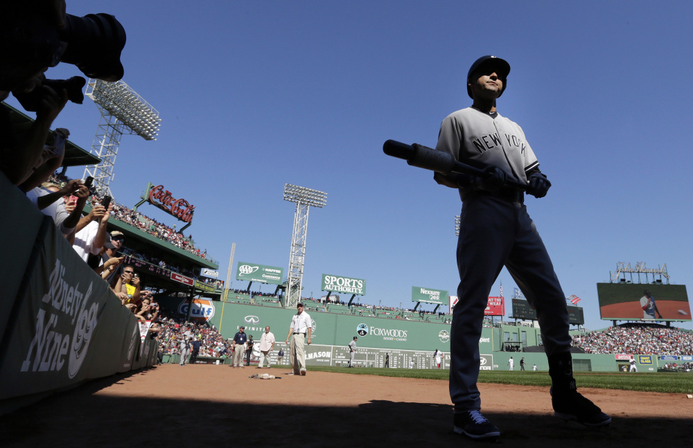 New York Yankees designated hitter Derek Jeter walks to the on-deck circle as he prepares to face the Boston Red Sox in the first inning Saturday at Fenway Park.