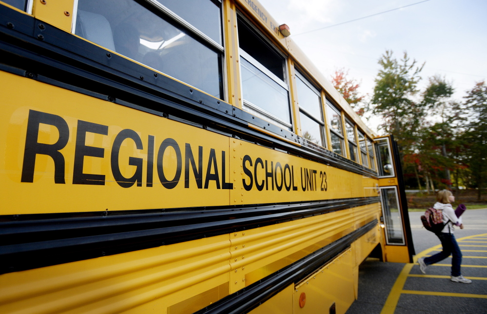 A student gets off a school bus at Loranger Middle School in Old Orchard Beach.