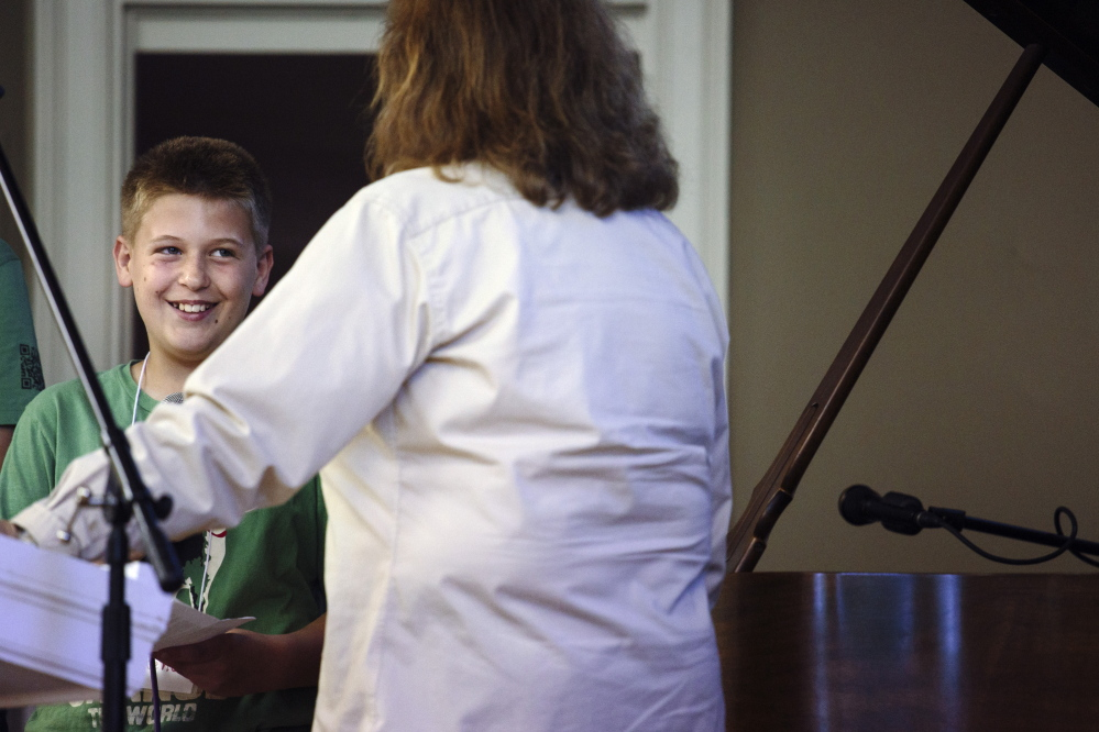 Ethan Reno, 10, a fifth-grade student at West Bath Elementray School, serves as an ambassador for Read to Feed. Whitney Hayward/Staff Photographer