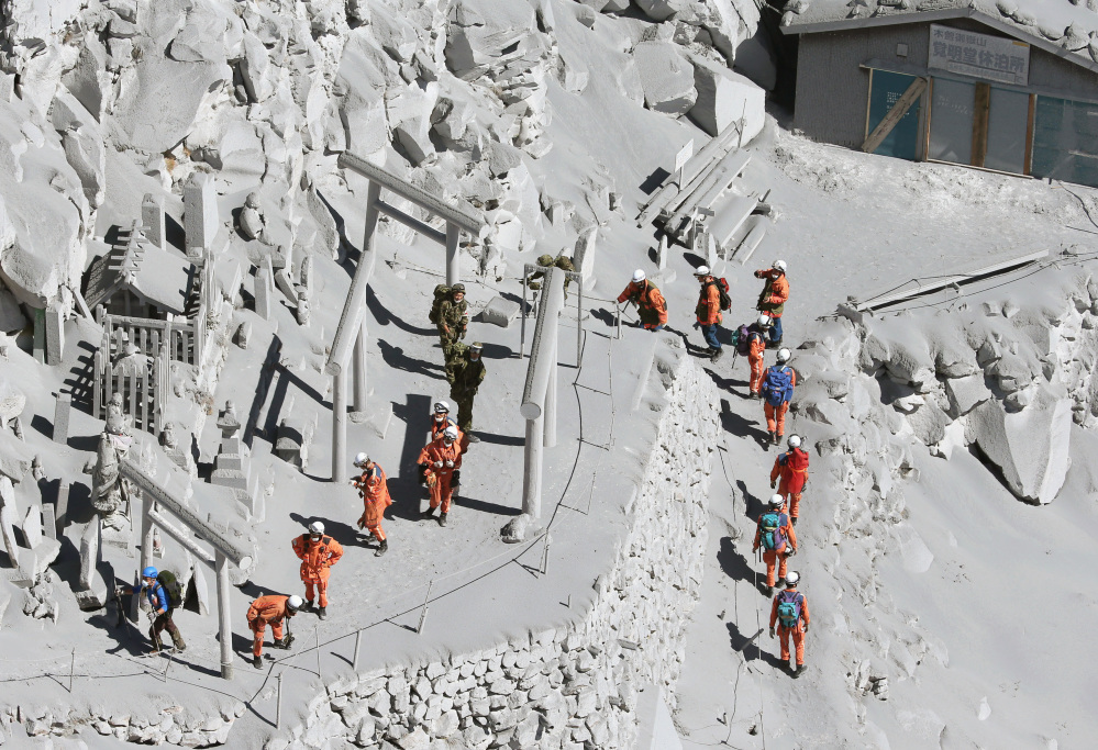 Firefighters advance to rescue climbers near the peak of Mount Ontake in central Japan on Sunday Mount Ontake erupted shortly before noon Saturday, spewing large white plumes of gas and ash high into the sky and blanketing the surrounding area in ash.