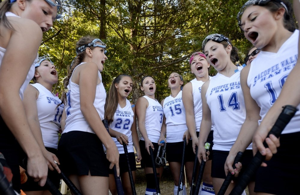 """Field hockey players at Sacopee Valley High School remember former teammate Lexi Valente in their """"hoo-ha'' chant before each game. Instead of ending it with the traditional """"Go Hawks,'' the players shout, """"Play for Lexi.''"""