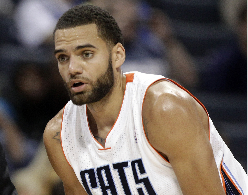 In this Nov. 10, 2012, file hoto, Charlotte Bobcats Jeffery Taylor listens to his coach during the first half of an NBA basketball game against the Dallas Mavericks in Charlotte, N.C.