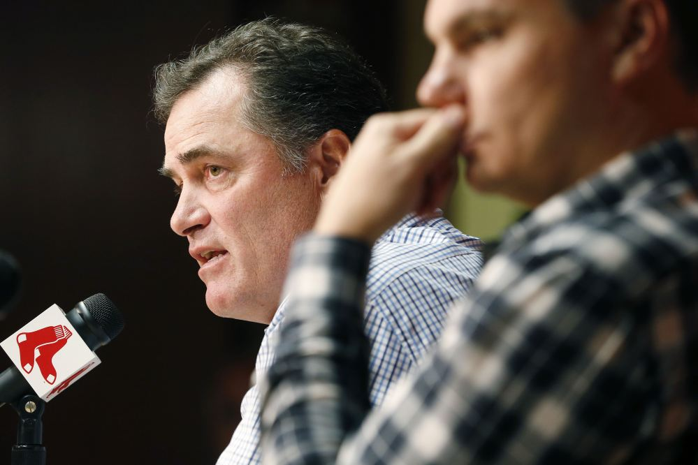 Boston Red Sox manager John Farrell, left, and general manager Ben Cherington take questions during a news conference at Fenway Park on Monday. A year after winning their third World Series in 10 years, the 2014 Red Sox finished last in the AL East, becoming the first team in baseball history to go from worst to first and back to worst in three consecutive seasons.