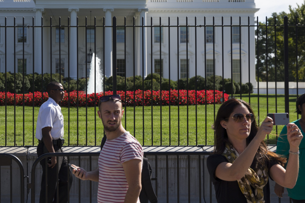 A Secret Service police officer stands outside the White House on Sept. 22. The intruder who climbed a fence made it farther inside the White House than the Secret Service has publicly acknowledged, the Washington Post and New York Times reported Monday, on the eve of a congressional oversight hearing with the director of the agency assigned to protect the president.
