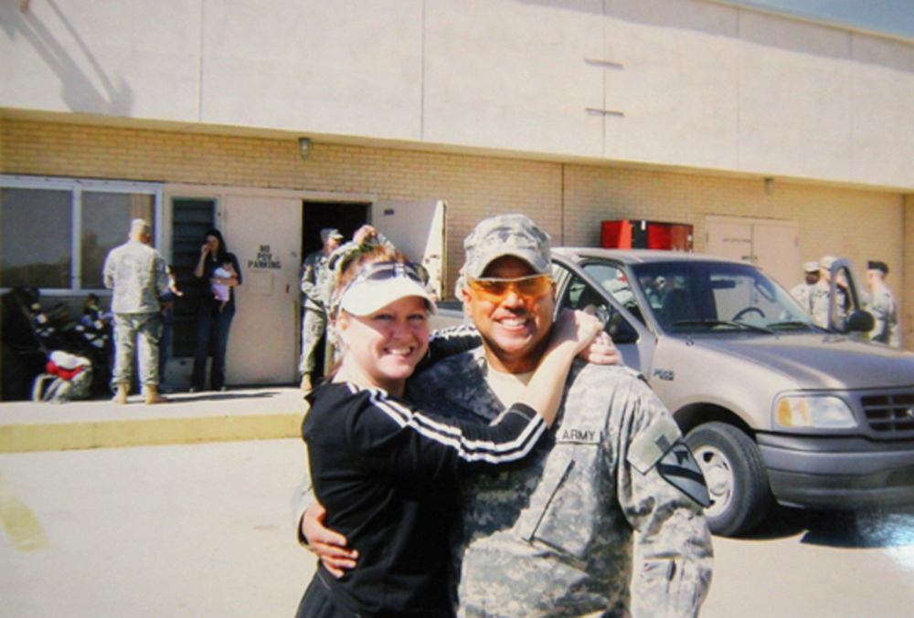 In this undated photo provided by Nancy Hoover, Omar Gonzalez poses for a photo in his Army uniform with his former wife Samantha, prior to an overseas deployment.  something rom story here
