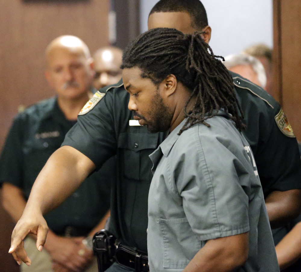 Jesse Leroy Matthew Jr. is escorted into a courtroom in Texas on Thursday, for a hearing to be extradited to Virginia, where he is charged in connection with a missing 18-year-old girl.