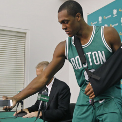 Boston's Rajon Rondo, recovering from hand surgery, picks up his cellphone after taking questions from reporters during the Celtics media day Monday in Waltham, Mass.
