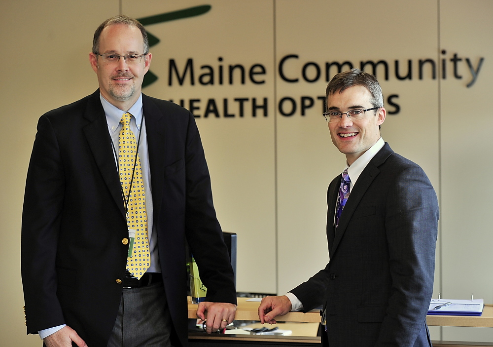 "Community Health Options CEO Kevin Lewis, right, seen with Chief Operating Officer Robert Hillman in 2013, said it wasn't an easy decision to drop abortion coverage, along with adult vision care, but both are ""non-essential health benefits"" under the Affordable Care Act."
