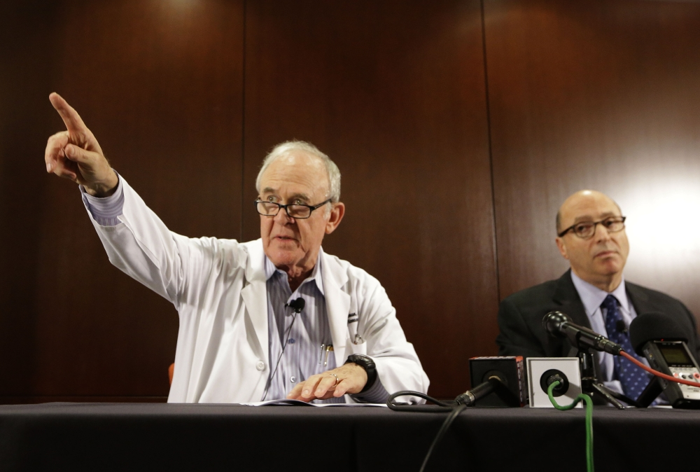 Dr. Edward Goodman, epidemiologist at Texas Health Presbyterian Hospital Dallas, points to a reporter with a question as Dr. Mark Lester looks on during a news conference about an Ebola-infected patient at the hospital. Federal health officials confirmed that it's the first Ebola case diagnosed in the United States.