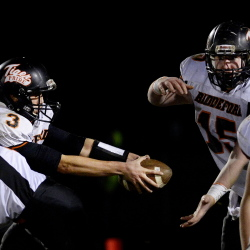 Biddeford's Casey Twomey fakes a handoff to Capen Macomber against  Bonny Eagle Friday, Nov. 7, 2014. Shawn Patrick Ouellette/Staff Photographer