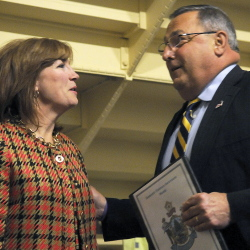 Susan Dench speaks Tuesday with Gov. Paul LePage as the Senate considers her nomination to the University of Maine System Board of Trustees. The Senate voted 17-15 to reject Dench.