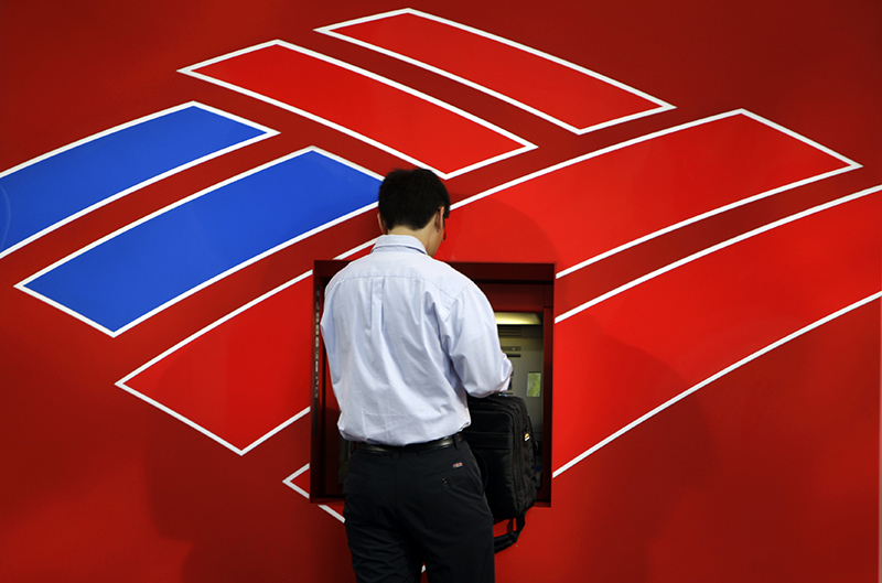 In this July 17, 2009 file photo, a customer uses a Bank of America ATM in Charlotte, N.C. The Associated Press